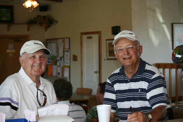 two golfers pictured at Coach's bar and grill