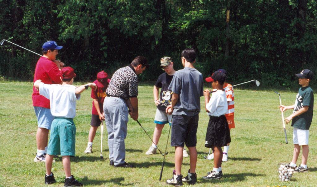 Kids participate in a junior golf program at Whispering Pines